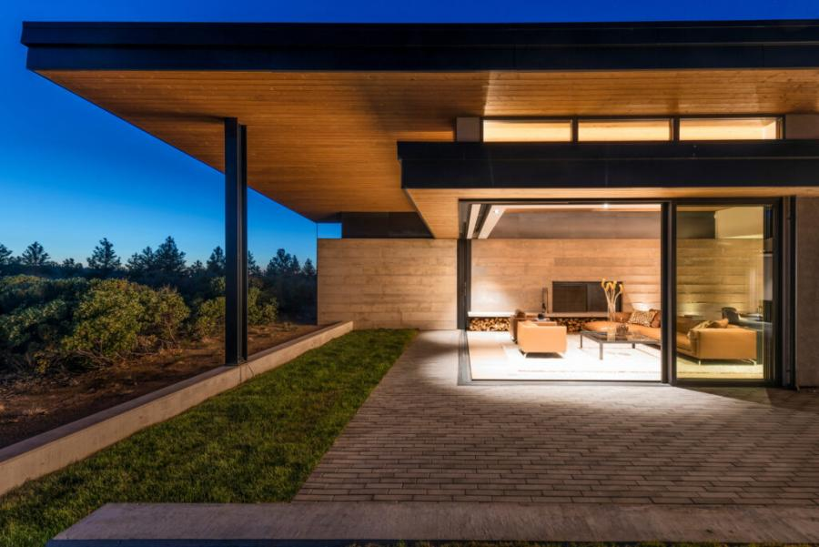 Solar design and biophilic design are the backbone of the High Desert Butterfly, a two-level custom home in Bend, Ore. Designed by Al Tozer and built by Copperline Homes, with J.S. Brown Design as interior designer and Ashley + Vance Engineering as structural engineer, the home features expansive glass walls and doors to maximize daylight, views, and indoor-outdoor living spaces. Photo: Kayla McKenzie Photography